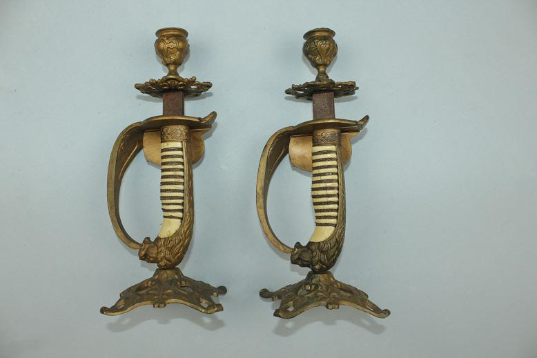 Naval sword candle sticks Early 20th century Faux ivory grips Folding guards www.swordsantiqueweapons.com