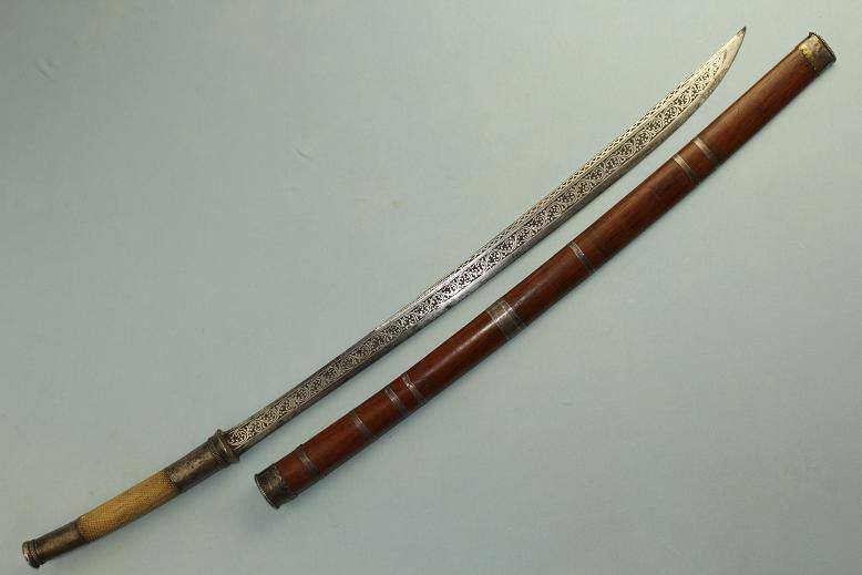 A fine Burmese sword Ivory hilted Dha Fine silver decorated blade www.swordsantiqueweapons.com