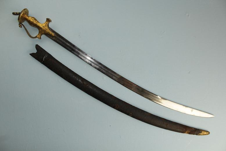 A very fine Tulwar Thick gold hilt Original high polished blade A rare untouched survivor www.swordsantiqueweapons.com